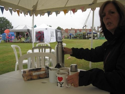 teatime in the tent - sheltering from the rain