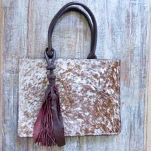 Brown cowhide designer handbag